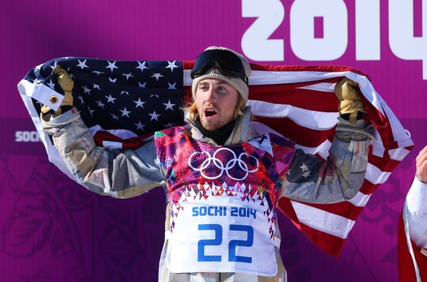 SOCHI, RUSSIA - FEBRUARY 08: Sage Kotsenburg of the United States celebrates winning gold after his second run during the Snowboard Men's Slopestyle Final during day 1 of the Sochi 2014 Winter Olympics at Rosa Khutor Extreme Park on February 8, 2014 in Sochi, Russia. (Photo by Julian Finney/Getty Images)