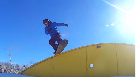 Jon Tollefson, boardslide on rainbow at Pine Knob