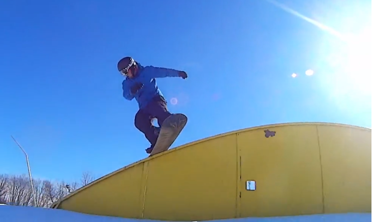 Jon Tollefson, boardslide on rainbow at Pine Knob