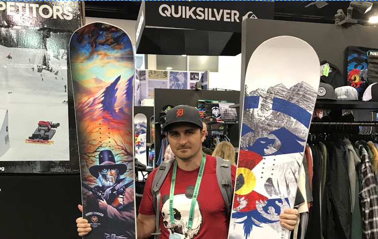 a person holding a snowboard